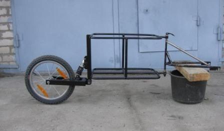Грузовой велоприцеп с амортизатором